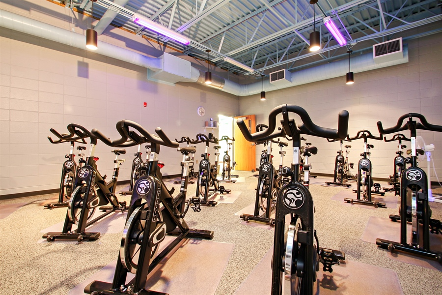 Real Estate Photography - 203 S Wells St, Lake Geneva, WI, 53147 - Spacious Cycle Studio with High-End Bikes
