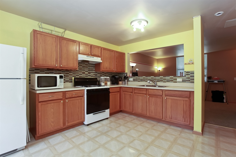 Real Estate Photography - 1515 S. Harding Ave, Chicago, IL, 60623 - Kitchen