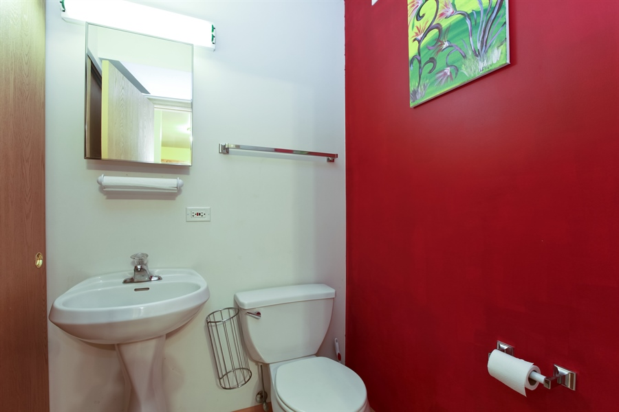 Real Estate Photography - 1515 S. Harding Ave, Chicago, IL, 60623 - Half Bath