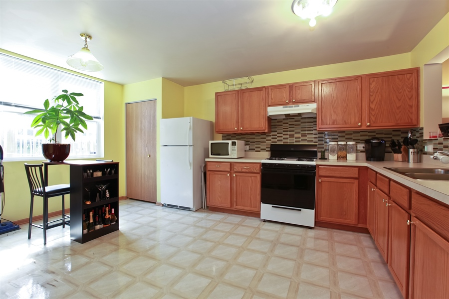 Real Estate Photography - 1515 S. Harding Ave, Chicago, IL, 60623 - Kitchen / Dining Room