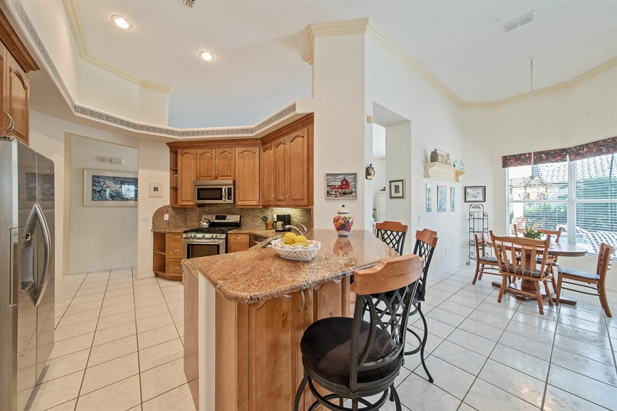 Real Estate Photography - 3561 Quill Leaf Ct, Bonita Springs, FL, 34134 - Kitchen / Breakfast Room