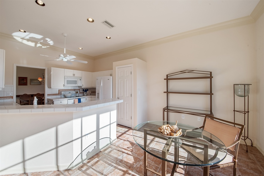 Real Estate Photography - 27197 Shell Ridge Cir, Bonita Springs, FL, 34134 - Kitchen / Breakfast Room
