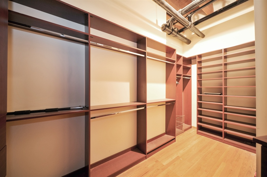 Real Estate Photography - 420 W Grand Ave, Unit 1A, Chicago, IL, 60654 - Master Bedroom Closet