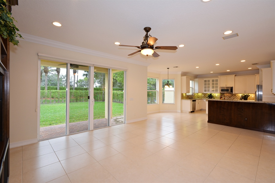 Real Estate Photography - 11186 Millpond Greens Dr, Boynton Beach, FL, 33473 - Family Room / Kitchen