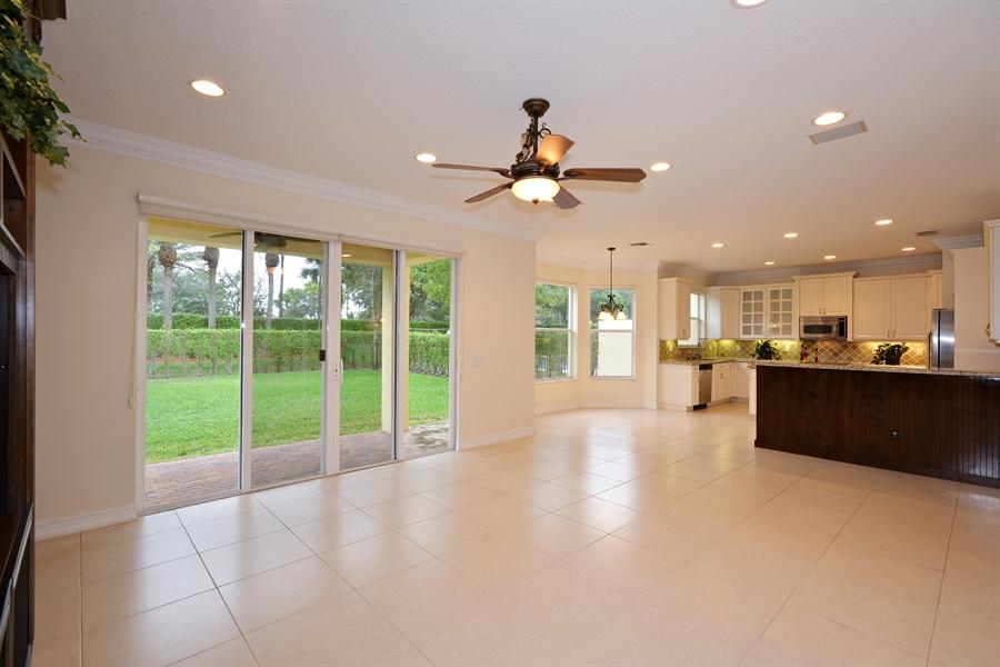 Real Estate Photography - 11186 Millpond Greens Dr, Boynton Beach, FL, 33473 - Family Room / Kitchen