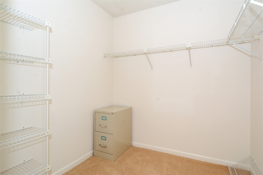 Real Estate Photography - 520 SE 12th St, Unit 103, Dania Beach, FL, 33004 - Master Bedroom Closet