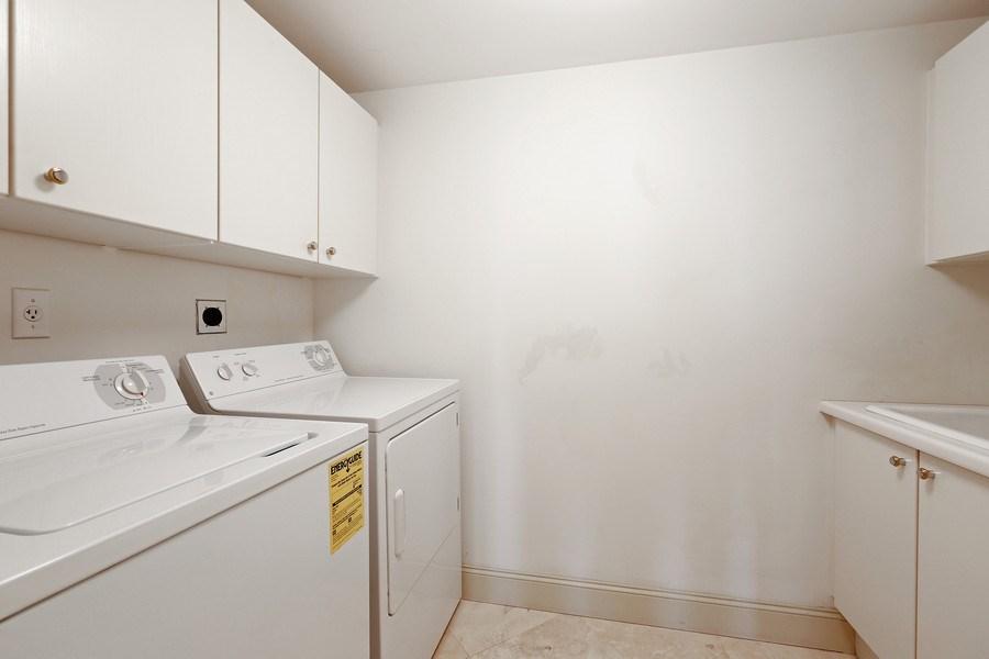 Real Estate Photography - 7000 Island Blvd, Apt 902, Aventura, FL, 33160 - Laundry Room