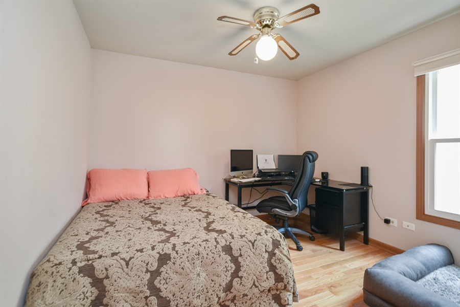 Real Estate Photography - 2946 W Nemesis Ave, Waukegan, IL, 60087 - Second Bedroom w/ Solid Oak Floors