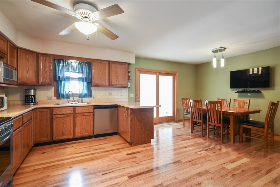 Real Estate Photography - 2946 W Nemesis Ave, Waukegan, IL, 60087 - Kitchen / Dining w/ Solid Oak Hardwood Floors