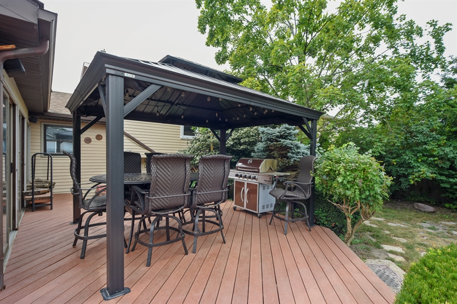 Real Estate Photography - 2946 W Nemesis Ave, Waukegan, IL, 60087 - Large Wrap Around Deck with Lighted Gazebo