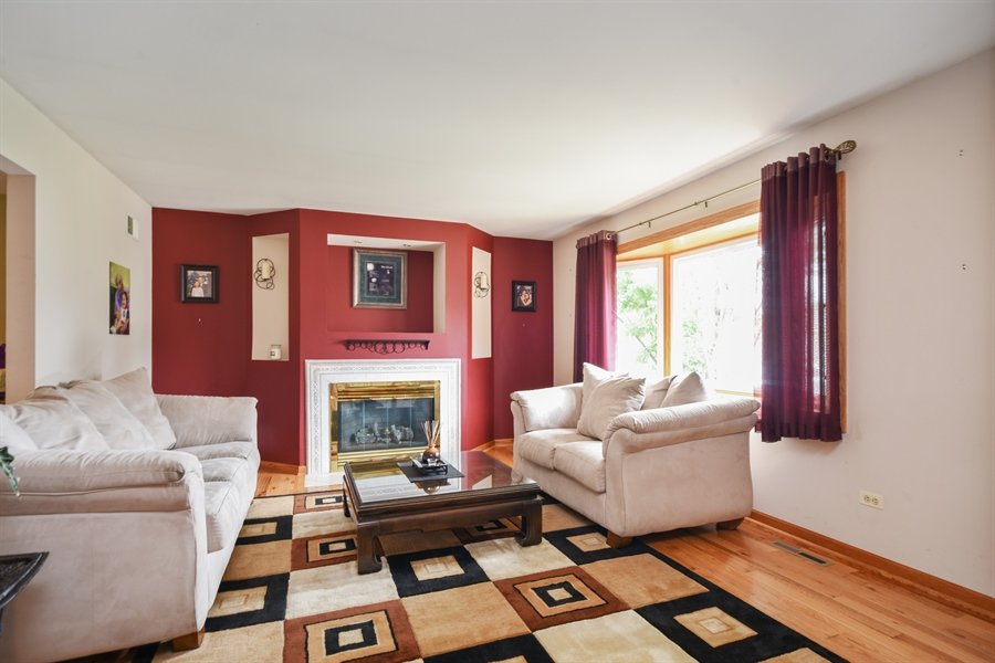 Real Estate Photography - 2946 W Nemesis Ave, Waukegan, IL, 60087 - Light and Bright Living Room w/ Fireplace