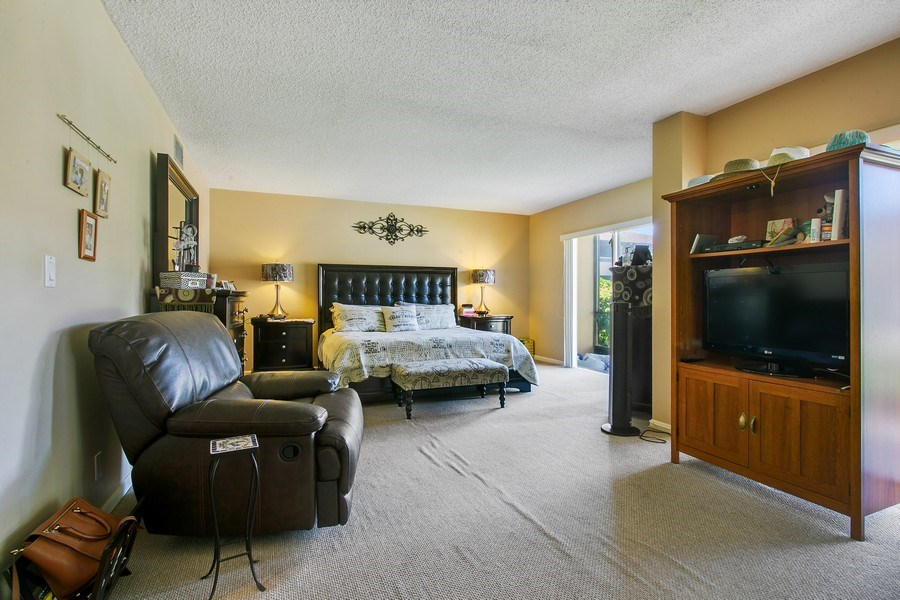 Real Estate Photography - 1100 Surf Road, Unit 106, Riviera Beach, FL, FL, 33404 - Master Bedroom
