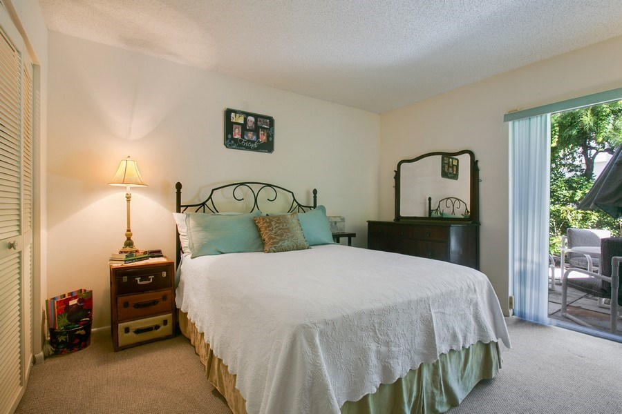 Real Estate Photography - 1100 Surf Road, Unit 106, Riviera Beach, FL, FL, 33404 - 3rd Bedroom