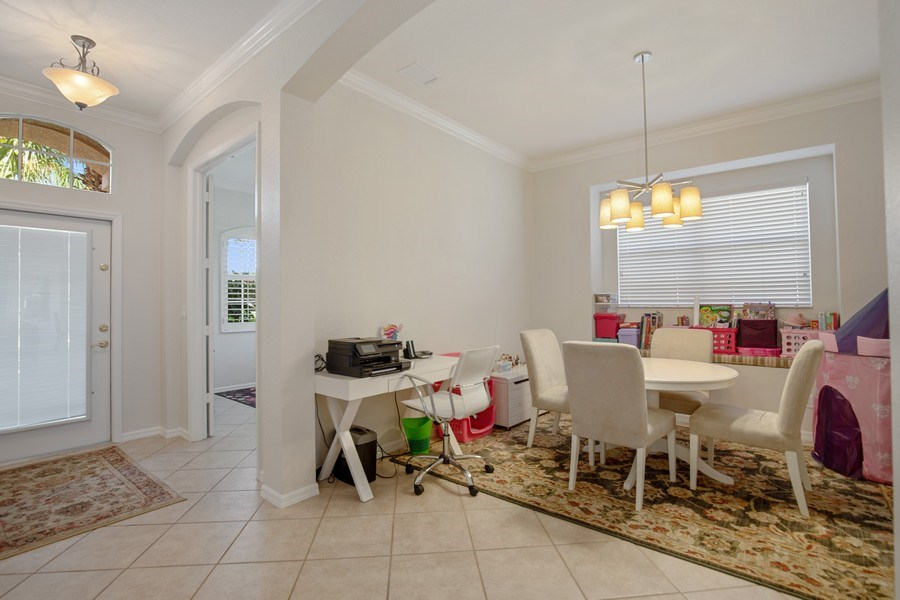 Real Estate Photography - 6136 Highwood Park Ln, Naples, FL, 34110 - Foyer/Dining Room