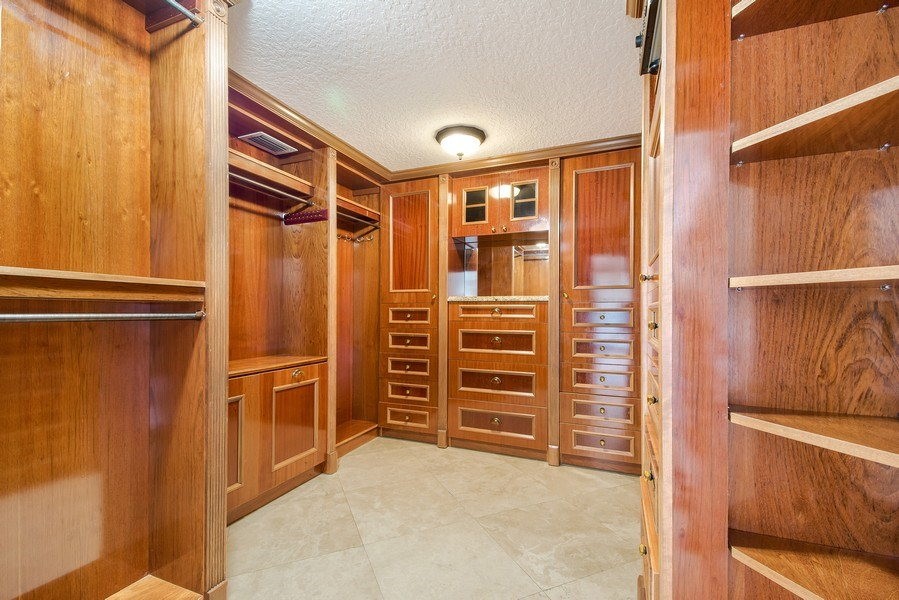 Real Estate Photography - 2641 NE 47th St, Lighthouse Point, FL, 33064 - Master Bedroom Closet