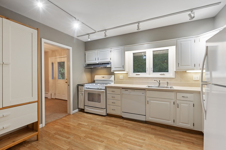 Real Estate Photography - 616 Harvard St, Wilmette, IL, 60091 - White Cabinet Kitchen looking toward Dining Rm