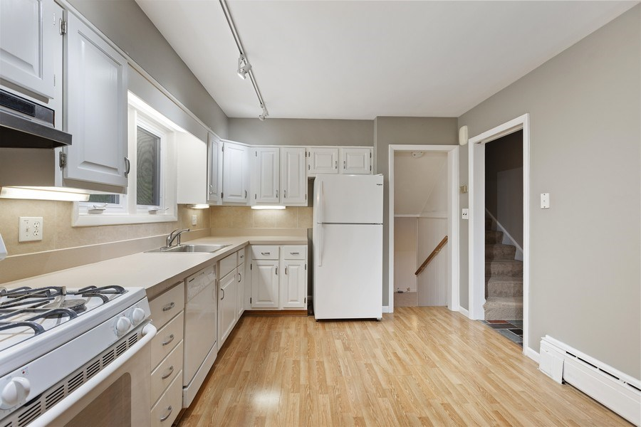 Real Estate Photography - 616 Harvard St, Wilmette, IL, 60091 - White Cabinet Kitchen w/Eating Area