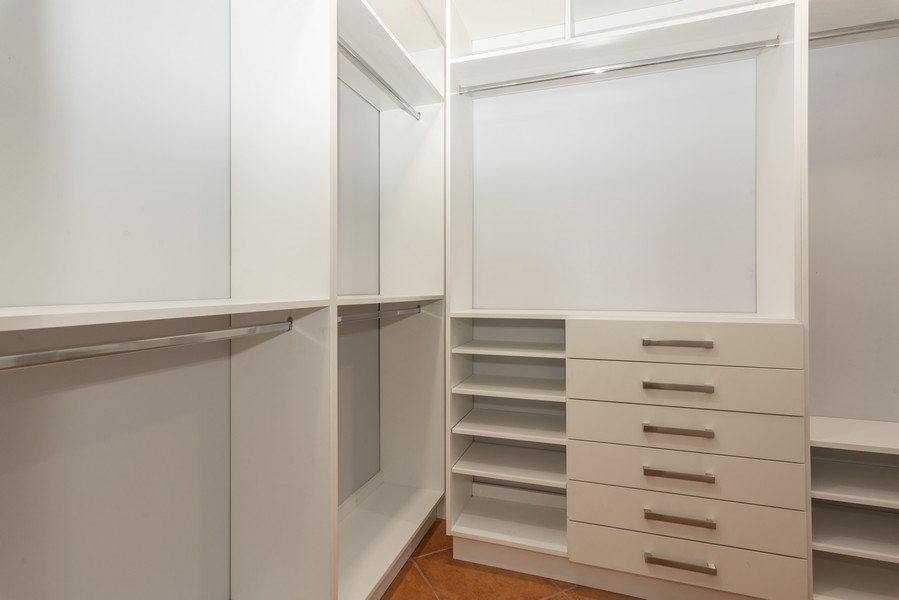 Real Estate Photography - 7505 SW 139th St, Palmetto Bay, FL, 33158 - Master Bedroom Closet