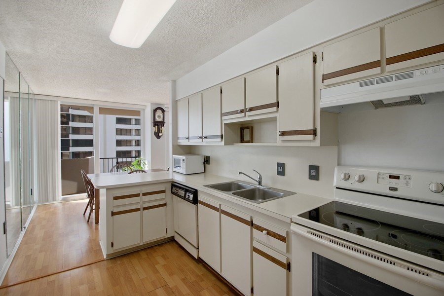 Real Estate Photography - 4200 N Ocean Dr 2, Unit 1203, Riviera Beach, FL, 33404 - Kitchen