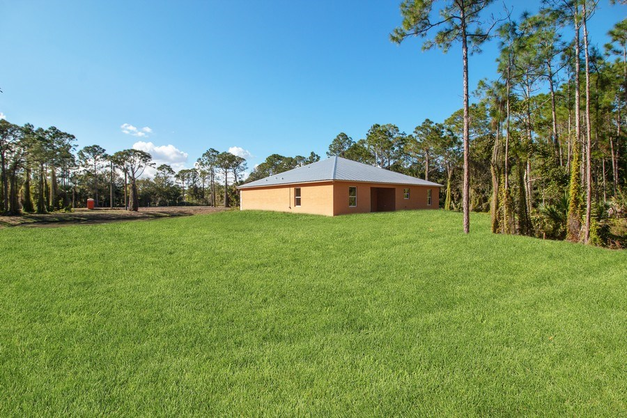 Real Estate Photography - 4093 SW 66th Ave, Palm City, FL, 34990 - Rear View