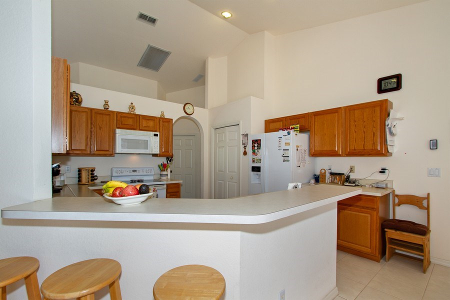 Real Estate Photography - 3930 24th Ave SE, Naples, FL, 34117 - Kitchen