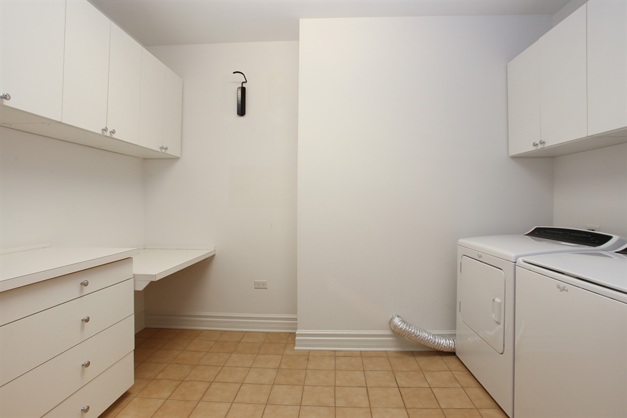 Real Estate Photography - 151 Wing, Unit 706, Arlington Heights, IL, 60005 - Laundry Room