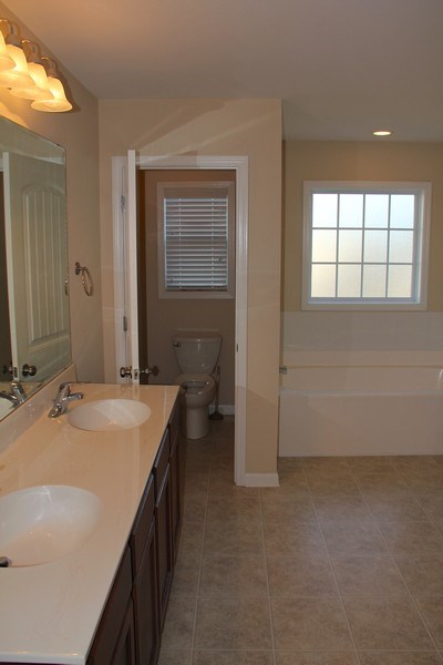 Real Estate Photography - 6409 Fawn Settle Dr, Wilmington, NC, 28409 - Master Bathroom