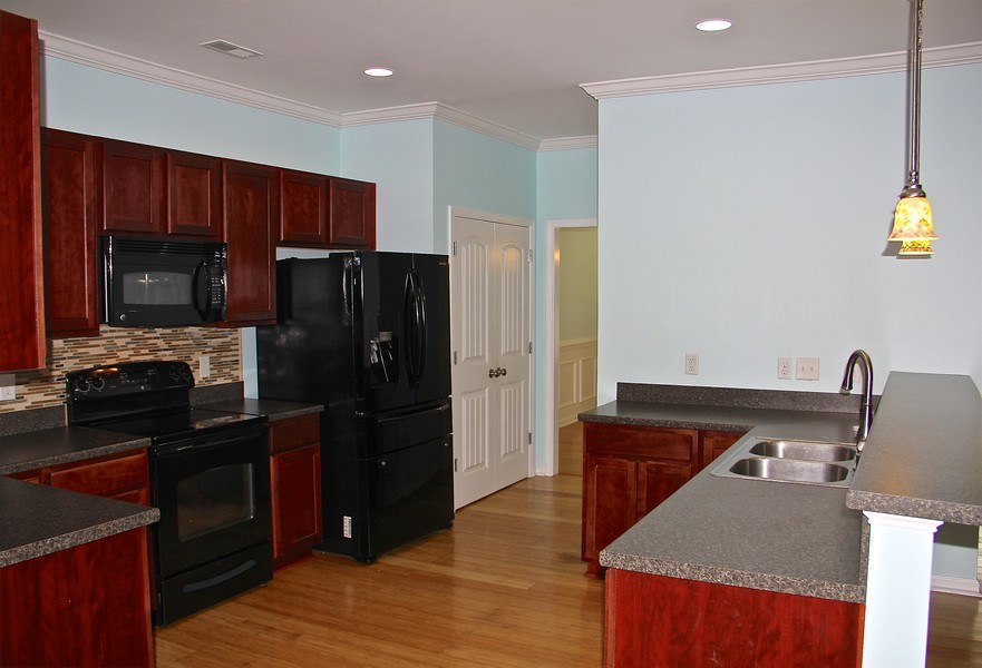 Real Estate Photography - 6409 Fawn Settle Dr, Wilmington, NC, 28409 - Kitchen