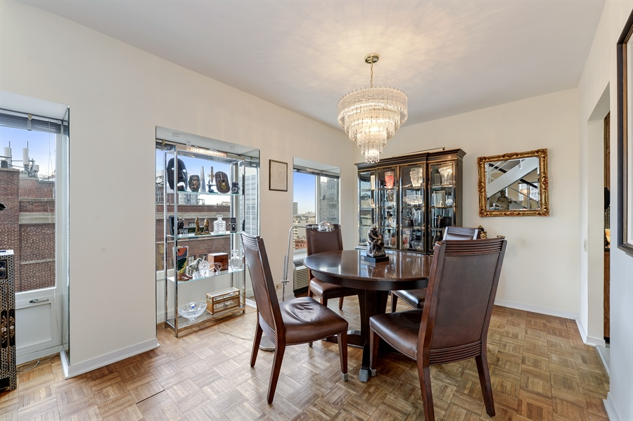 Real Estate Photography - 1100 N Lake Shore Dr, Unit 19C, Chicago, IL, 60611 - Dining Room