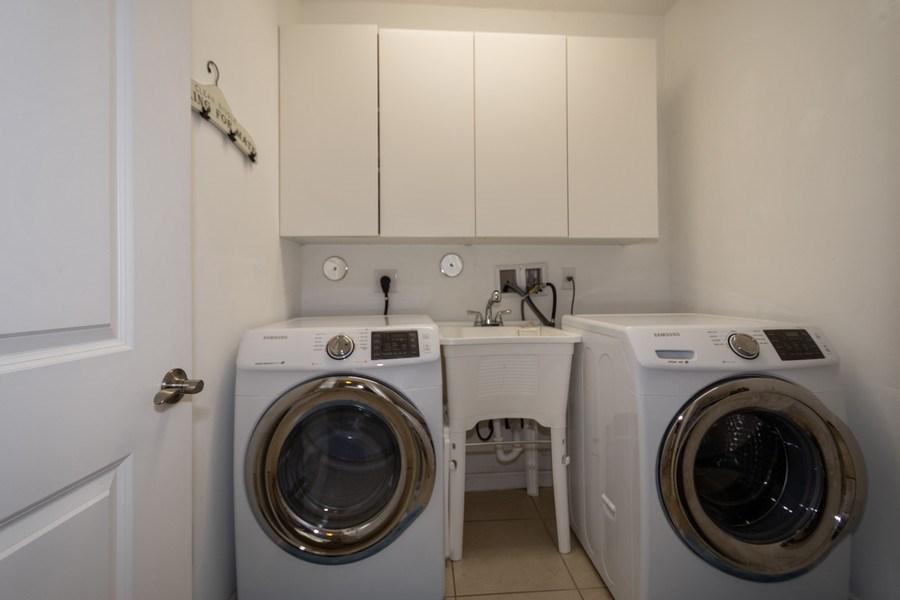 Real Estate Photography - 2906 Cascada Isle Way, Cooper City, FL, 33024 - Laundry Room