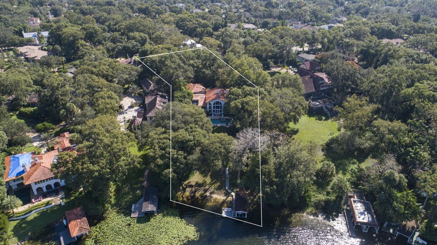 Real Estate Photography - 581 Sylvan Dr, Winter Park, FL, 32789 - Aerial View from Lake