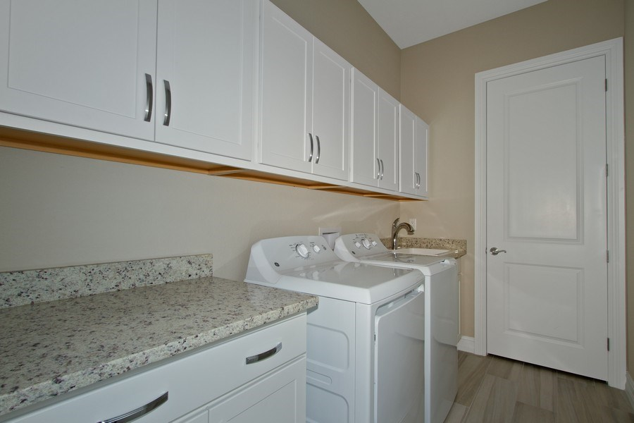 Real Estate Photography - 7801 Hawthorne Dr, Unit 2703, Naples, FL, 34113 - Laundry Room