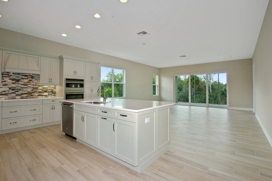Real Estate Photography - 7801 Hawthorne Dr, Unit 2703, Naples, FL, 34113 - Kitchen / Living Room