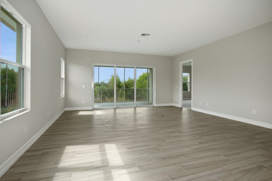 Real Estate Photography - 7801 Hawthorne Dr, Unit 2703, Naples, FL, 34113 - Living Room/Dining Room