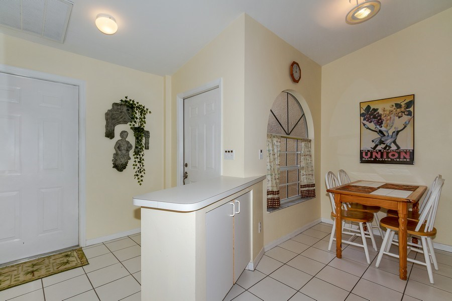 Real Estate Photography - 8047 Palamino Dr, Naples, FL, 34113 - Breakfast Nook