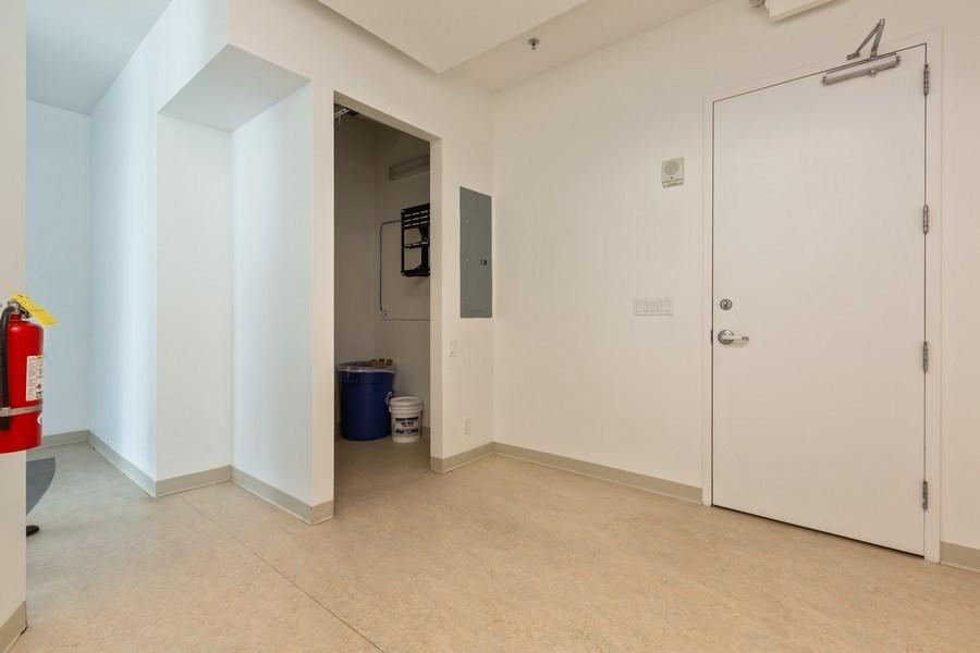 Real Estate Photography - 20900 NE 30 Ave, Suite 910, Aventura, FL, 33180 - Storage room