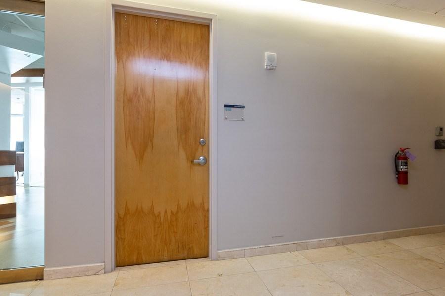 Real Estate Photography - 20900 NE 30 Ave, Suite 910, Aventura, FL, 33180 - Office  910 Exterior