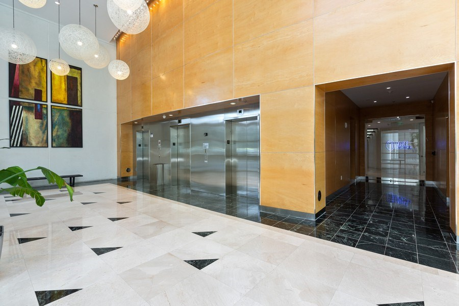 Real Estate Photography - 20900 NE 30 Ave, Unit 910, Aventura, FL, 33183 - Building elevators