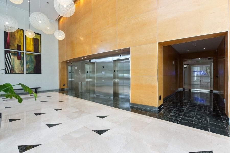Real Estate Photography - 20900 NE 30 Ave, Suite 910, Aventura, FL, 33180 - Building elevators