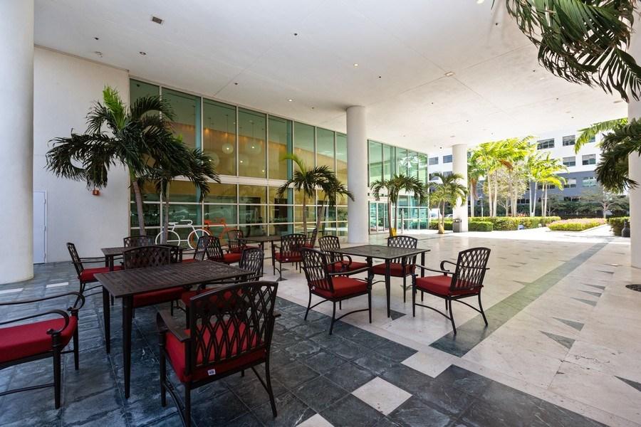 Real Estate Photography - 20900 NE 30 Ave, Suite 910, Aventura, FL, 33180 - Building Coffee Shop