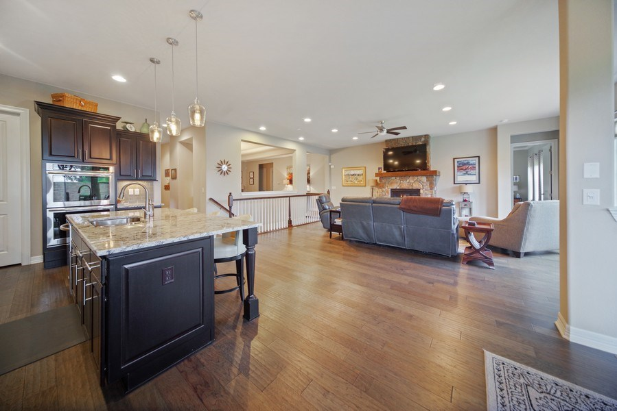 Real Estate Photography - 1650 Tiverton Ave, Broomfield, CO, 80023 - Kitchen / Living Room