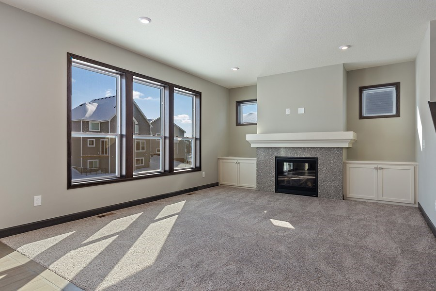 Real Estate Photography - 5118 Suntide Pass, Woodbury, MN, 55129 - Living Room