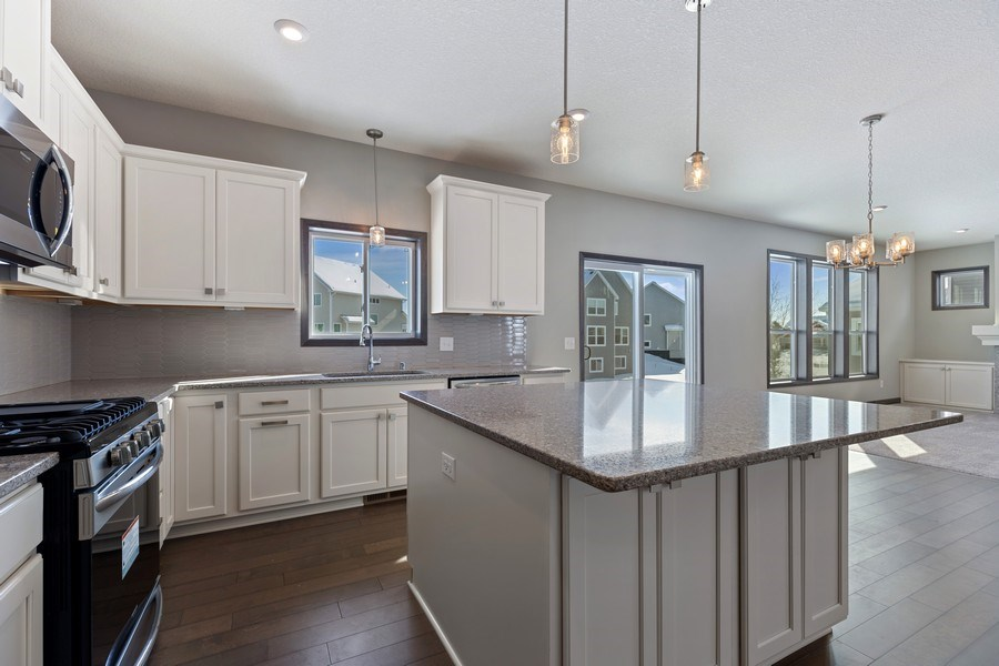 Real Estate Photography - 5118 Suntide Pass, Woodbury, MN, 55129 - Kitchen