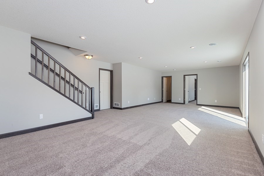 Real Estate Photography - 5118 Suntide Pass, Woodbury, MN, 55129 - Family Room
