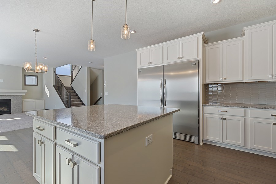 Real Estate Photography - 5118 Suntide Pass, Woodbury, MN, 55129 - Kitchen / Living Room