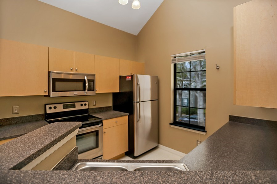 Real Estate Photography - 730 Siena Place, Apt 201, Kissimmee, FL, 34747 - Kitchen