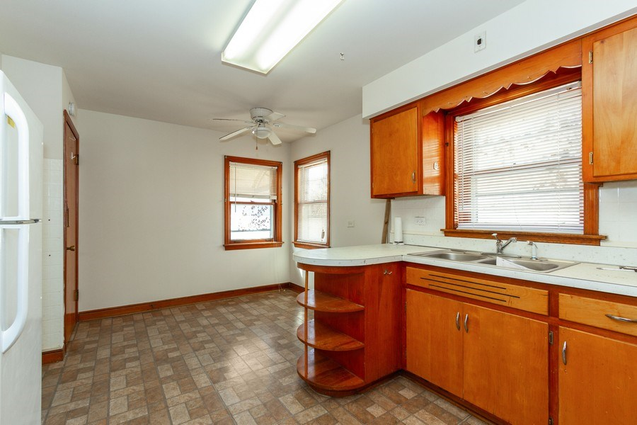 Real Estate Photography - 14132 Dearborn St, Riverdale, IL, 60827 - Kitchen / Breakfast Room