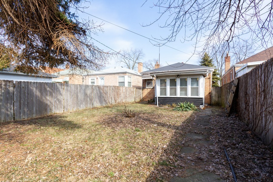 Real Estate Photography - 14132 Dearborn St, Riverdale, IL, 60827 - Rear View