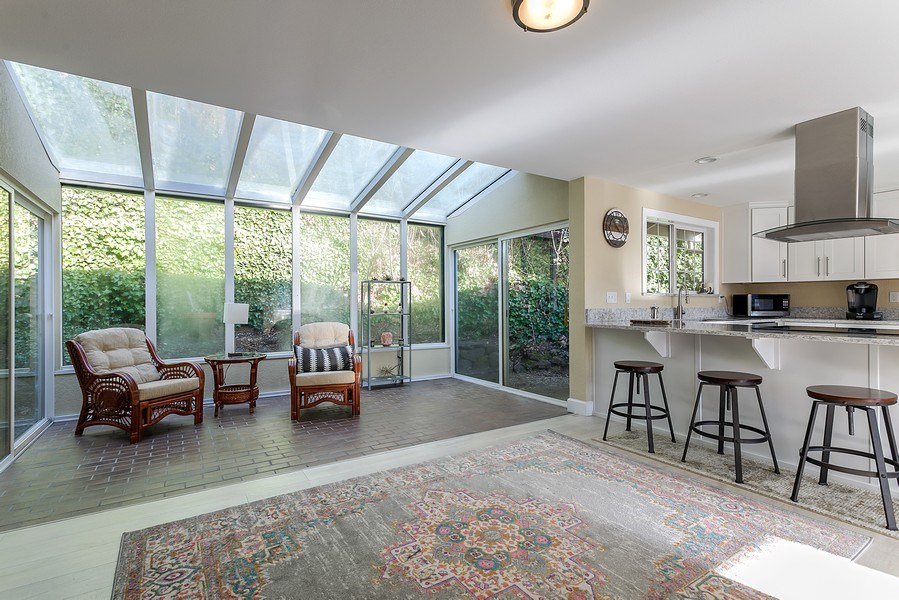 Real Estate Photography - 3615 East Bay Drive, Gig Harbor, WA, 98335 - Family Room / Kitchen