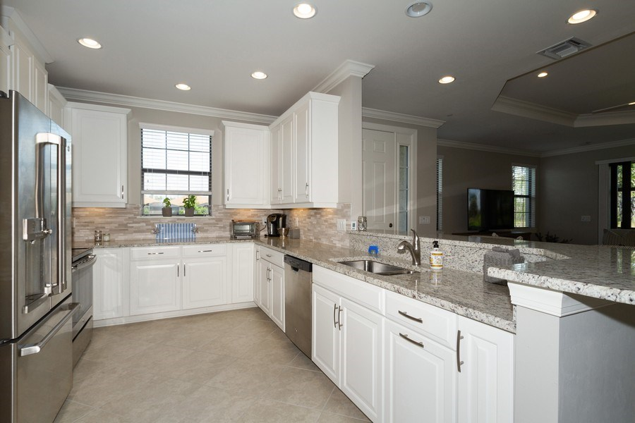 Real Estate Photography - 8777 Bellano Ct #101, Naples, FL, 34119 - Kitchen